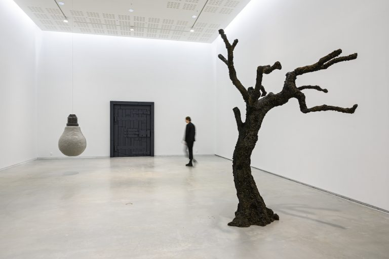 UGO RONDINONE. a wall. a door. a tree. a lightbulb. winter.