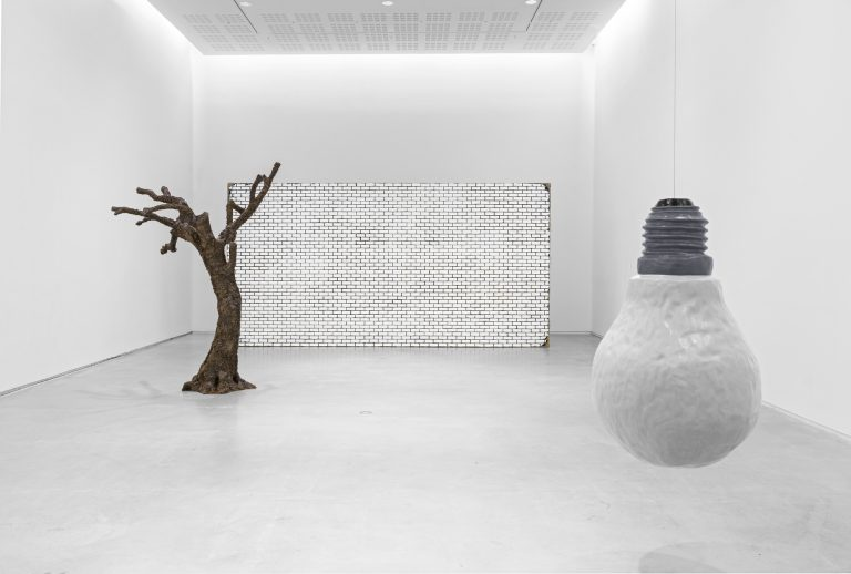UGO RONDINONE. a wall. a door. a tree. a lightbulb. winter.